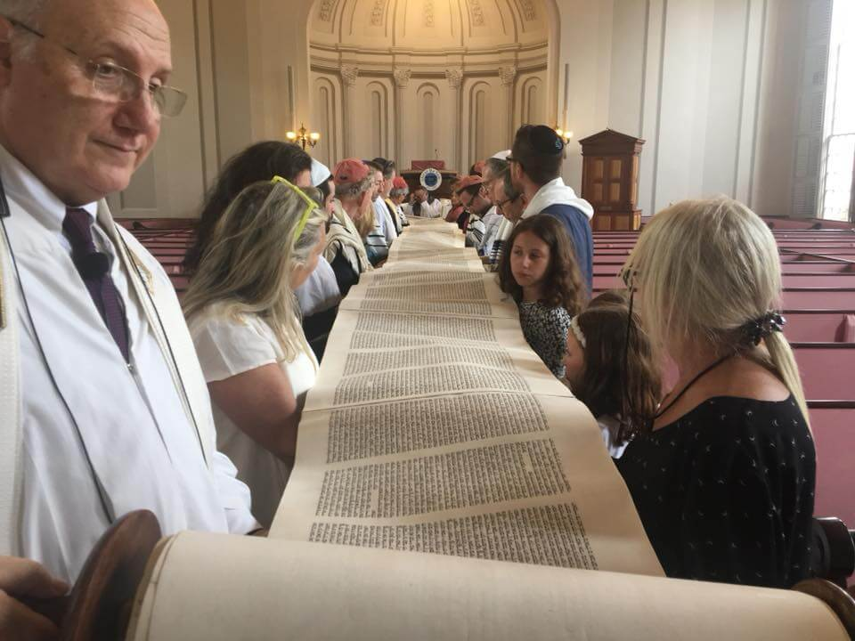 Congregation holding the torah.