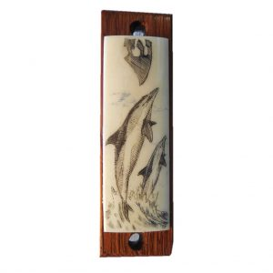 Ivory scrimshaw mezzuzah of two dolphins.