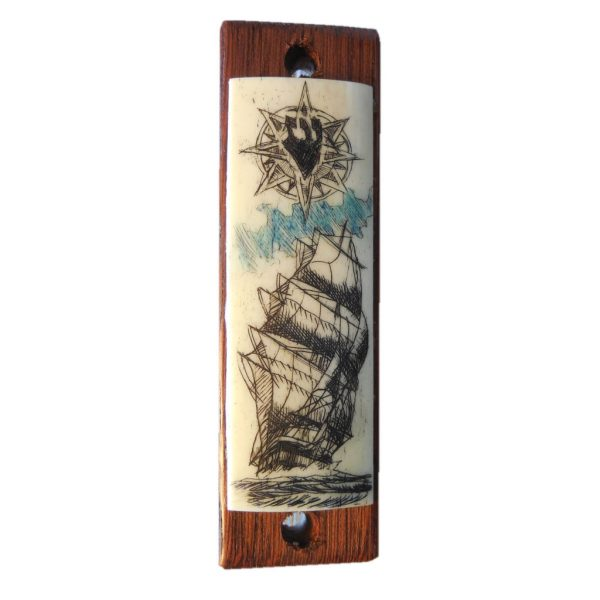 Ivory scrimshaw mezzuzah of a ship.