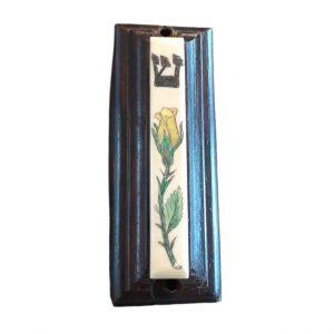 Ivory scrimshaw mezzuzah of a yellow tulip.