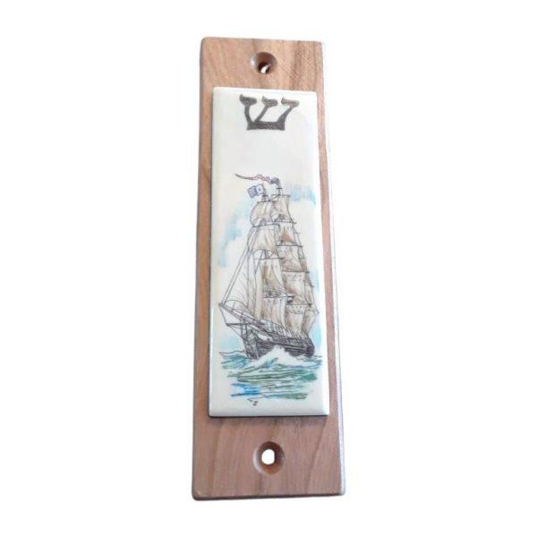 Ivory scrimshaw mezzuzah of a ship.